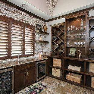 Transitional travertine floor and multicolored floor wine cellar photo in Houston with diamond bins