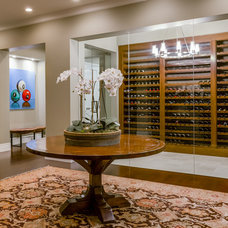 Traditional Wine Cellar by KL Interiors