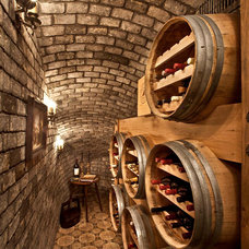 Mediterranean Wine Cellar by Palmer Interior Design