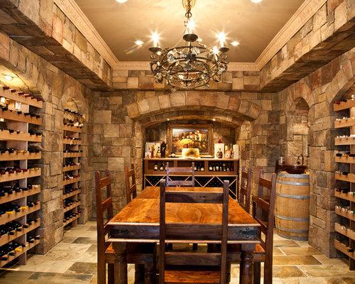 Example Of A Large Tuscan Terra Cotta Floor And Beige Floor Wine Cellar  Design In
