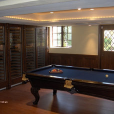 Traditional Wine Cellar by Anthony James Construction