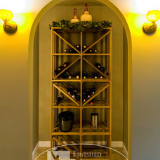 Traditional Wine Cellar by Finished Basement Company
