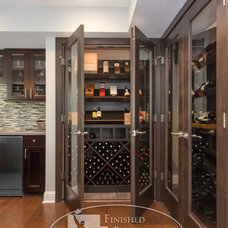 Modern Wine Cellar by Finished Basement Company