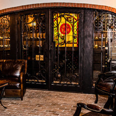 mediterranean wine cellar by Kitty Raulston-Thomas Interior Designs