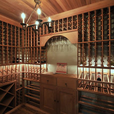 Traditional Wine Cellar by Innovative Construction Inc.