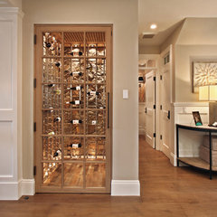 traditional wine cellar by Patterson Construction Corporation