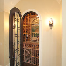 Mediterranean Wine Cellar by Devonshire Custom Homes