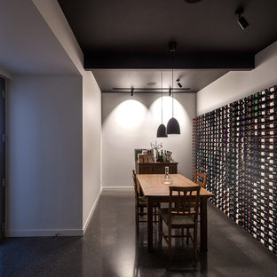 Mid-sized modern wine cellar in Melbourne with concrete floors, grey floor and storage racks.