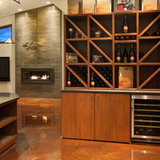 Contemporary Wine Cellar by L.EvansDesignGroup,inc