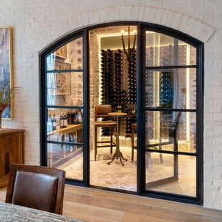 Example of a mid-sized transitional brick floor and gray floor wine cellar design in Houston with display racks