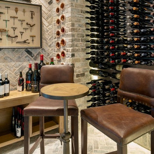 Inspiration for a mid-sized transitional brick floor and gray floor wine cellar remodel in Houston with display racks