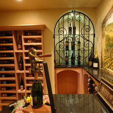 Traditional Wine Cellar by Barenz Builders