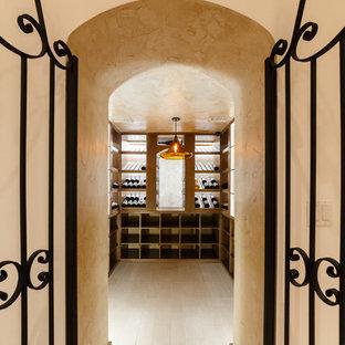 Foto de bodega minimalista, extra grande, con suelo de mármol, botelleros y suelo blanco