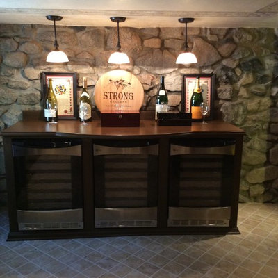 Inspiration for a large craftsman wine cellar remodel in Los Angeles with display racks
