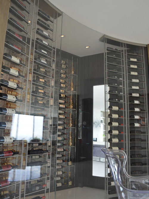 Wine cellar design ideas renovations photos with marble for Wine cellar flooring options