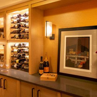 На фото: винный погреб в стиле современная классика с полом из терракотовой плитки, стеллажами и черным полом