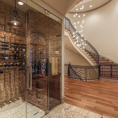 Example of a classic brick floor and beige floor wine cellar design in Dallas with storage racks