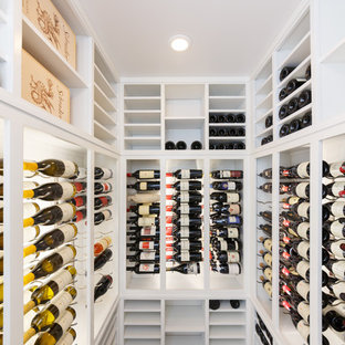 Inspiration for a mid-sized contemporary marble floor wine cellar remodel in New York with storage racks