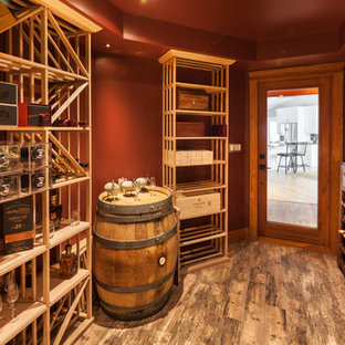 Photo of a small traditional wine cellar in Other with ceramic flooring and display racks.