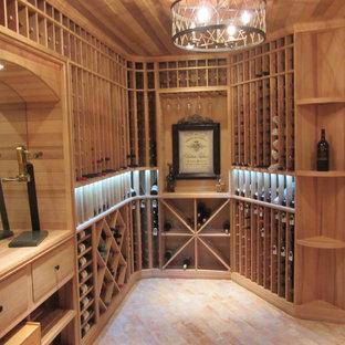 Idéer för att renovera en mellanstor vintage vinkällare, med tegelgolv, vinställ med diagonal vinförvaring och rött golv