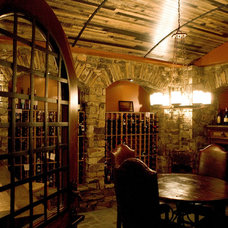 Traditional Wine Cellar by Adam C. Dover LLC.