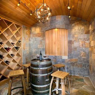 Idéer för en mellanstor medelhavsstil vinkällare, med vinställ med diagonal vinförvaring, flerfärgat golv och skiffergolv