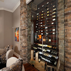 Transitional Wine Cellar by Christopher Burton Homes, Inc.
