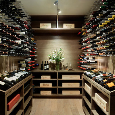 Inspiration for a large contemporary light wood floor and beige floor wine cellar remodel in San Francisco with storage racks