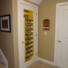 Traditional Wine Cellar by Mahogany Builders