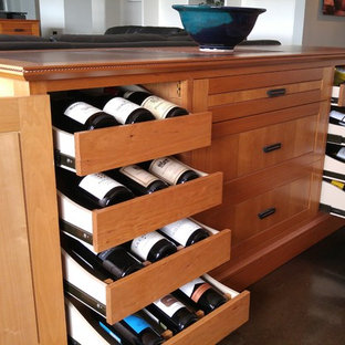 Example of an arts and crafts wine cellar design in Phoenix