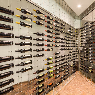 Photo of a contemporary wine cellar in Toronto with display racks and cork flooring.