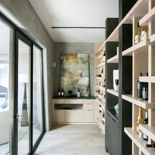 Design ideas for a contemporary wine cellar in Orange County with light hardwood flooring and beige floors.