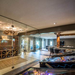 This is an example of a large midcentury wine cellar in Other with ceramic floors.