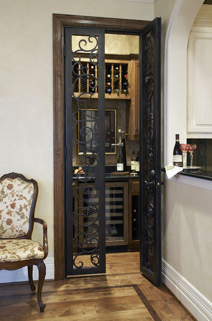 Traditional Wine Cellar by CDA Interior Design