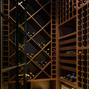 Inspiration for a small contemporary wine cellar in London with medium hardwood flooring and cube storage.