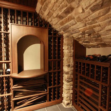 Traditional Wine Cellar by Metro Design Group