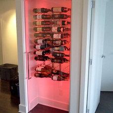 Modern Wine Cellar by Vitrévolution inc.