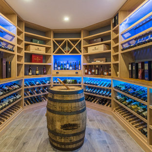 Wine cellar - traditional brown floor wine cellar idea in New York with display racks