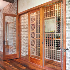 Traditional Wine Cellar by Ink Architecture + Interiors