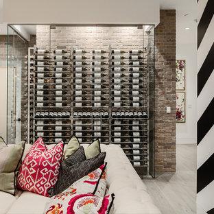 Réalisation d'une cave à vin design avec un sol en bois clair et des casiers.