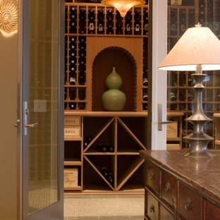This is an example of a medium sized vintage wine cellar in Milwaukee with porcelain flooring and storage racks.