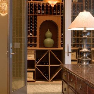 Foto de bodega romántica, de tamaño medio, con suelo de baldosas de porcelana y botelleros