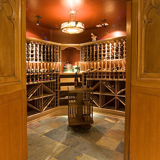 Example of a large classic multicolored floor wine cellar design in Denver with storage racks
