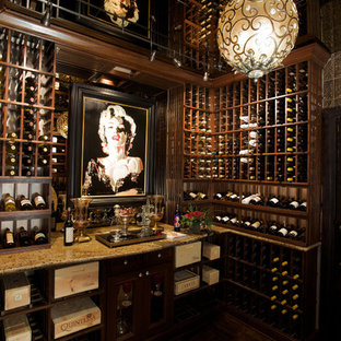 Inspiration for an expansive victorian wine cellar in Phoenix with dark hardwood flooring, storage racks and brown floors.