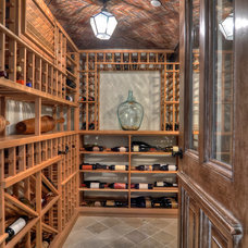 Traditional Wine Cellar by James Glover Residential & Interior Design