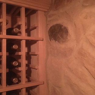 Inspiration for a large classic wine cellar in Cincinnati with concrete flooring, storage racks and grey floors.