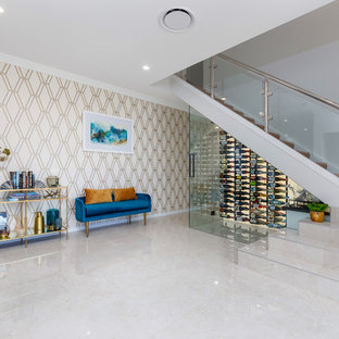 Photo of a contemporary wine cellar in Brisbane with display racks and beige floor.