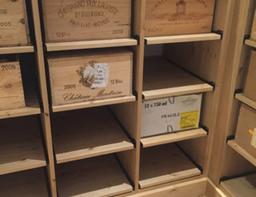 Compact wine room in Henley on Thames using case racks, cubes and shelves