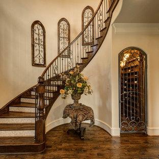 Mid-sized tuscan medium tone wood floor and brown floor wine cellar photo in Dallas with storage racks