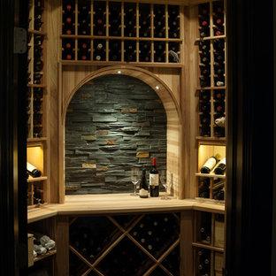 Small minimalist concrete floor wine cellar photo in Wichita with storage racks